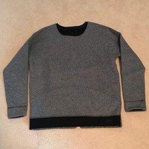 Gray and black Lululemon sweatshirt.